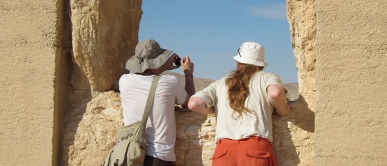 Picture 3: People looking out of window in ancient ruin